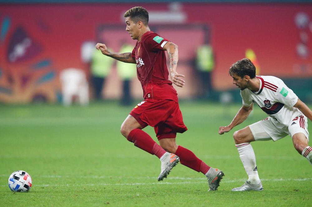 Roberto Firmino comemora gol que deu vitória a Liverpool - Foto: CRISTIANO ANDUJAR/FUTURA PRESS/ESTADÃO CONTEÚDO